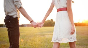 couple-holding-hands-walking